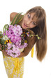 Beautiful girl holds a bunch of flowers, isolated