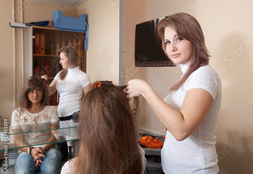 hairdresser working with  girl