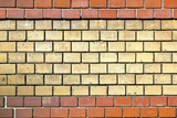 wall of bricks with mixed colors giving a harmonic pattern poster