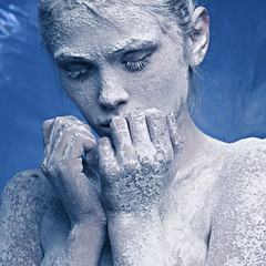 Portrait of a beautiful girl in the frost on his face