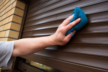 hand cleaning roller shutters