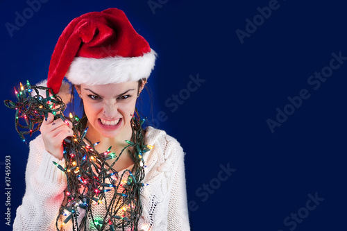 Panicked girl with Christmas lights - 37459593