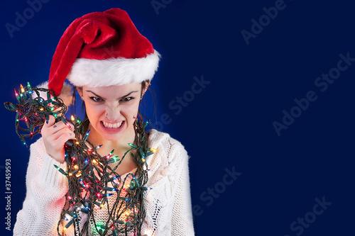 Leinwanddruck Bild Panicked girl with Christmas lights