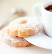 Butter biscuits with icing sugar and coffee