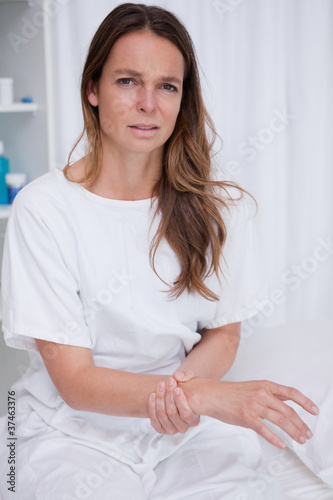 Woman feeling her pulse