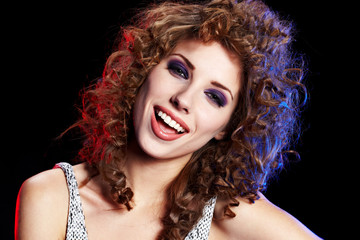attractive smiling woman portrait on black background