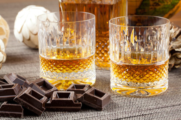 Chocolate and fine bourbon whiskey in crystal tumblers