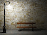 Illuminated brick wall with old fashioned street light and bench - 37465399
