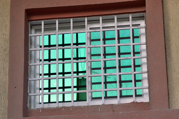 Window glass green Concrete column with a reflection upon