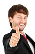 Smiling businessman thumbs up isolated