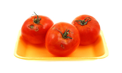 Looking Down Three Blemished Tomatoes