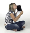 cute blonde girl kissing her laptop