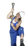 hammering girl dressed in workwear poster