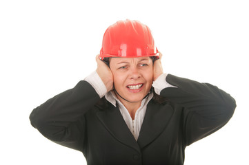 women with a protective helmet, the noise bothers