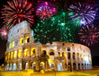 Celebratory fireworks over Collosseo. Italy. Rome.