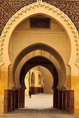 Ornate arches of passageway into mosque courtyard Morocco