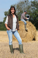 farmer standing in front of her husband