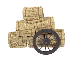 Stagecoach Wheel Leaning on Bales of Hay