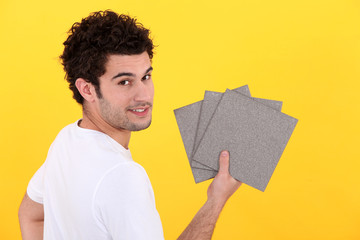 Man holding tiles