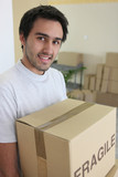 Man carrying a cardboard box on moving day