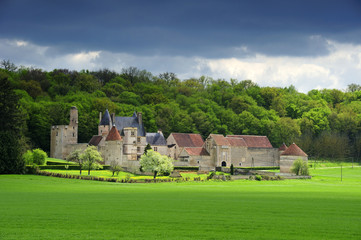 French chateau under stormy skies
