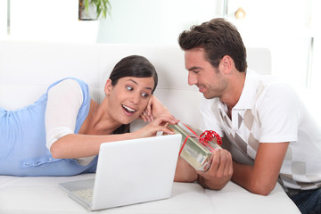 Man offering present to wife