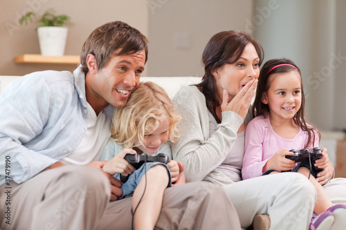 Competitive family playing video games