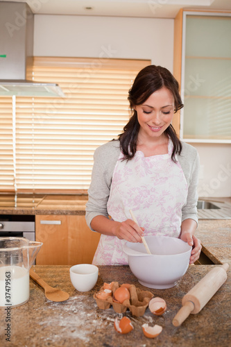 Portrait of a smiling woman baking