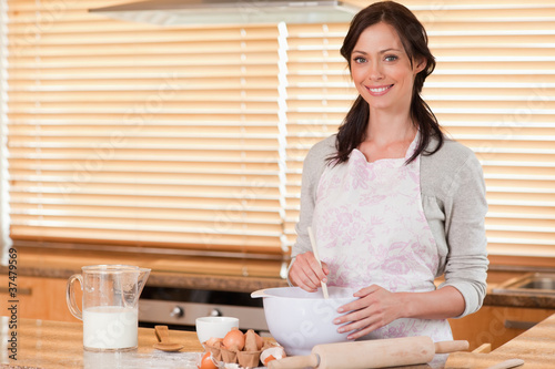 Beautiful woman baking