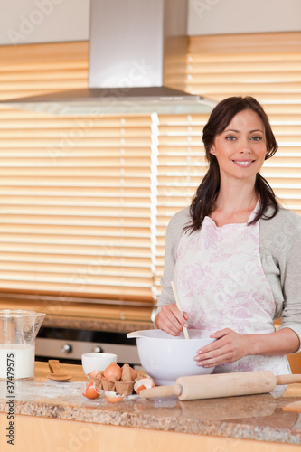 Portrait of a beautiful woman baking