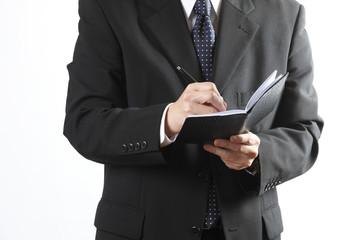 ノートを取るビジネスマン