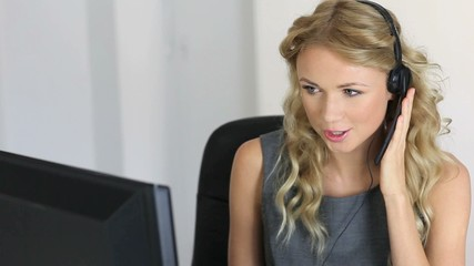 Beautiful customer service woman with headset on