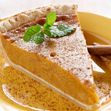 Fototapety pumpkin pie with mint garnish.
