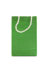 Green paper bag isolated in white background