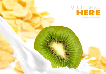 Milk splash with kiwi on corn flakes background