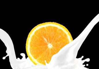 Splashing milk with orange