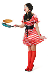 Young beautiful housewife with frying pan on white