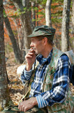 Man smoking in forest 15
