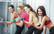 healthy woman doing fitness exercise with dumbbell