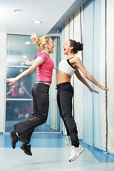 healthy woman jumping at fitness training gym