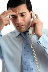 Stressed  depressed man businessman on phone