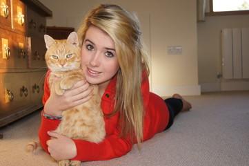 Girl Cuddling Her Cat