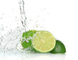 Green limes with splashing water