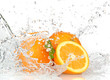 Orange fruits with Splashing water