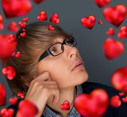 Image of young man thinking of his plans about Valentine day and