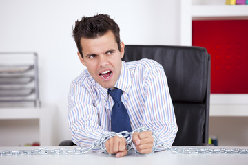 Businessman captive at his office