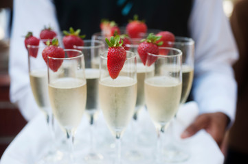 Waiter Serves Champagne on Tray