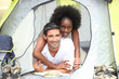 interracial couple in a canvas tent