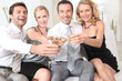Two couples drinking champagne together