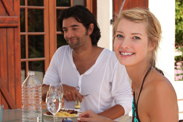 Young couple having lunch alfresco